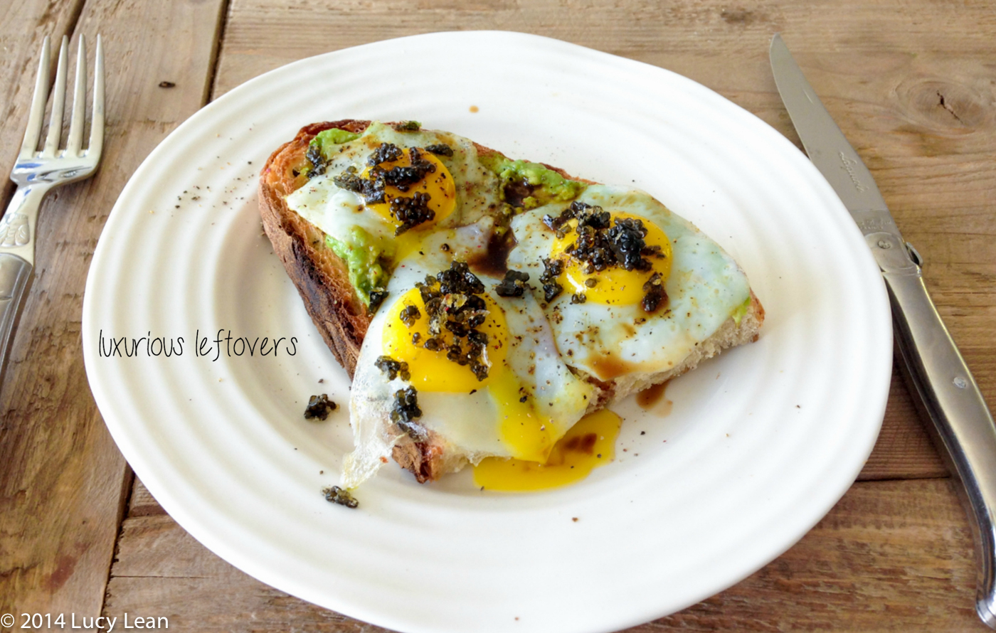quails eggs and caviar on avocado toast